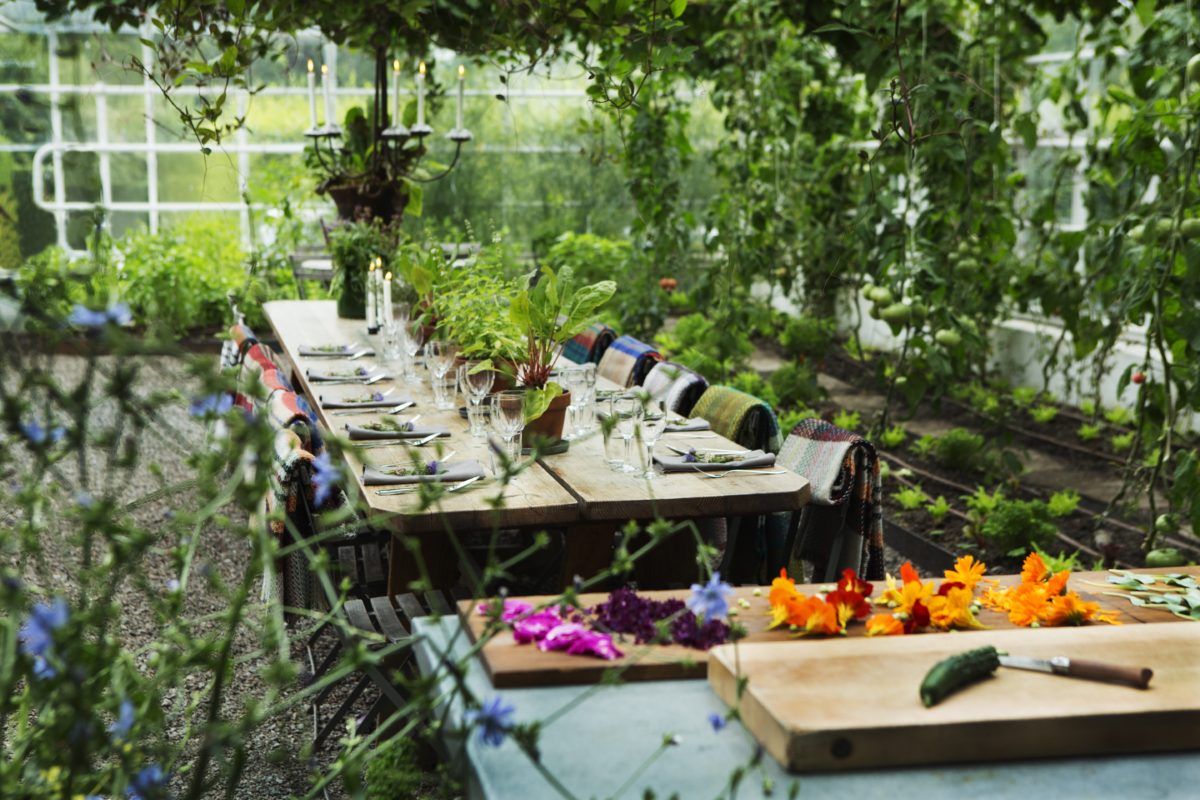 A decorated table in a garden in Sweden.