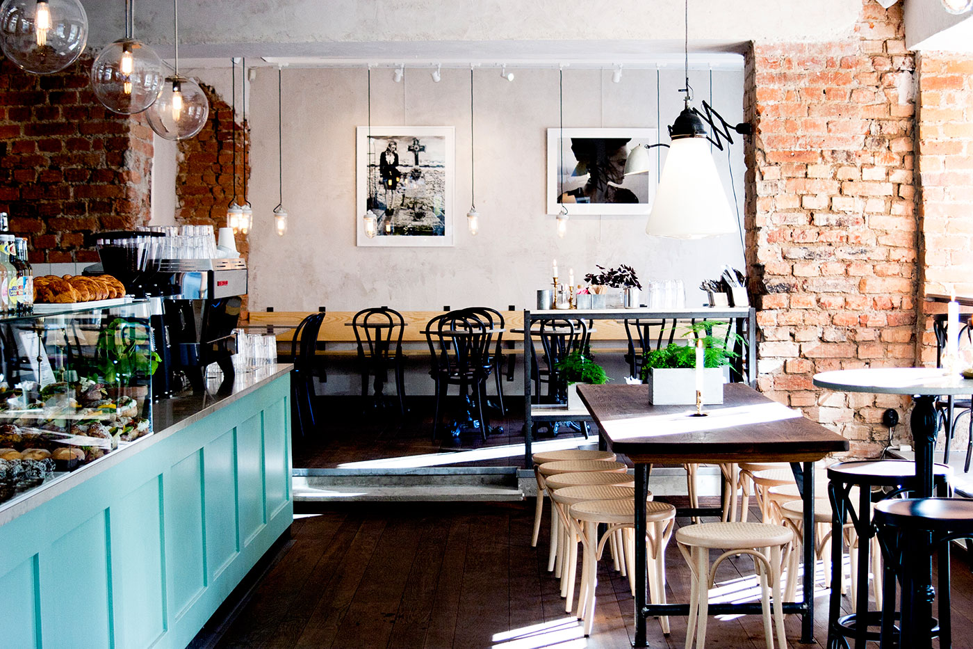 Photo of inside of a cafe with chairs and tables.
