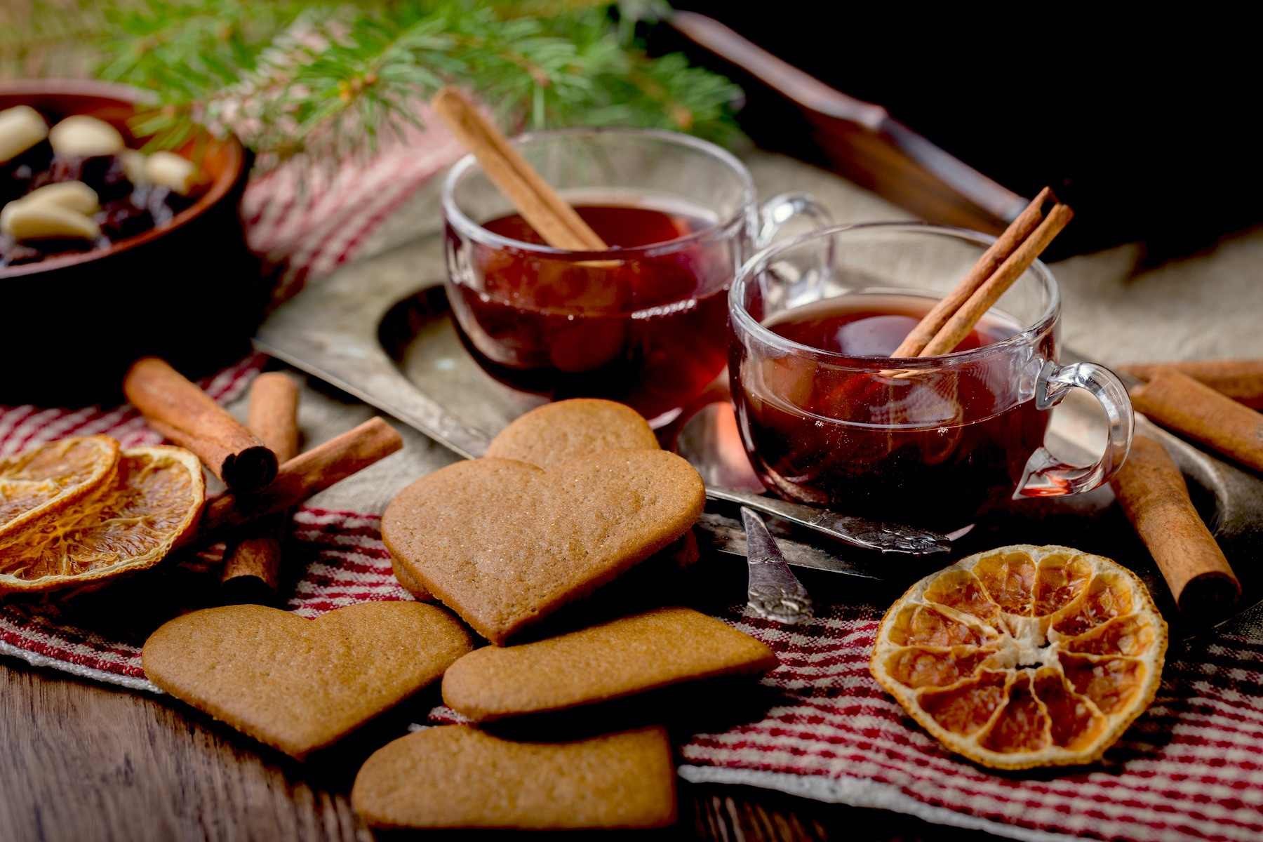 Gingerbread cookies and mulled wine on a table.