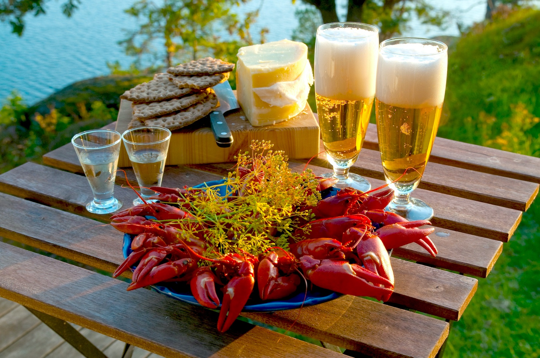 Crayfish, beer, and crackers on a table outside