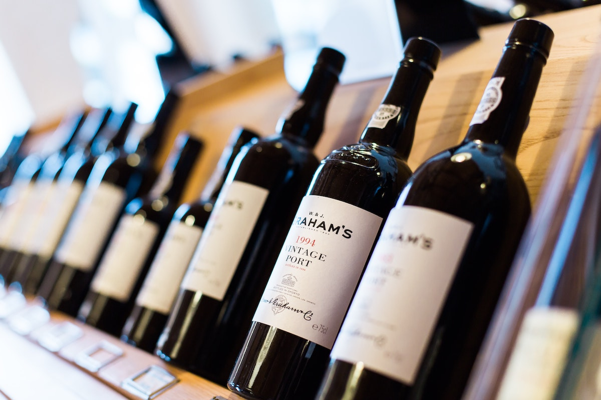 Liquor bottles on a wooden shelf
