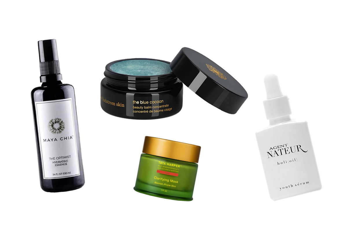 4 different skincare products on white background