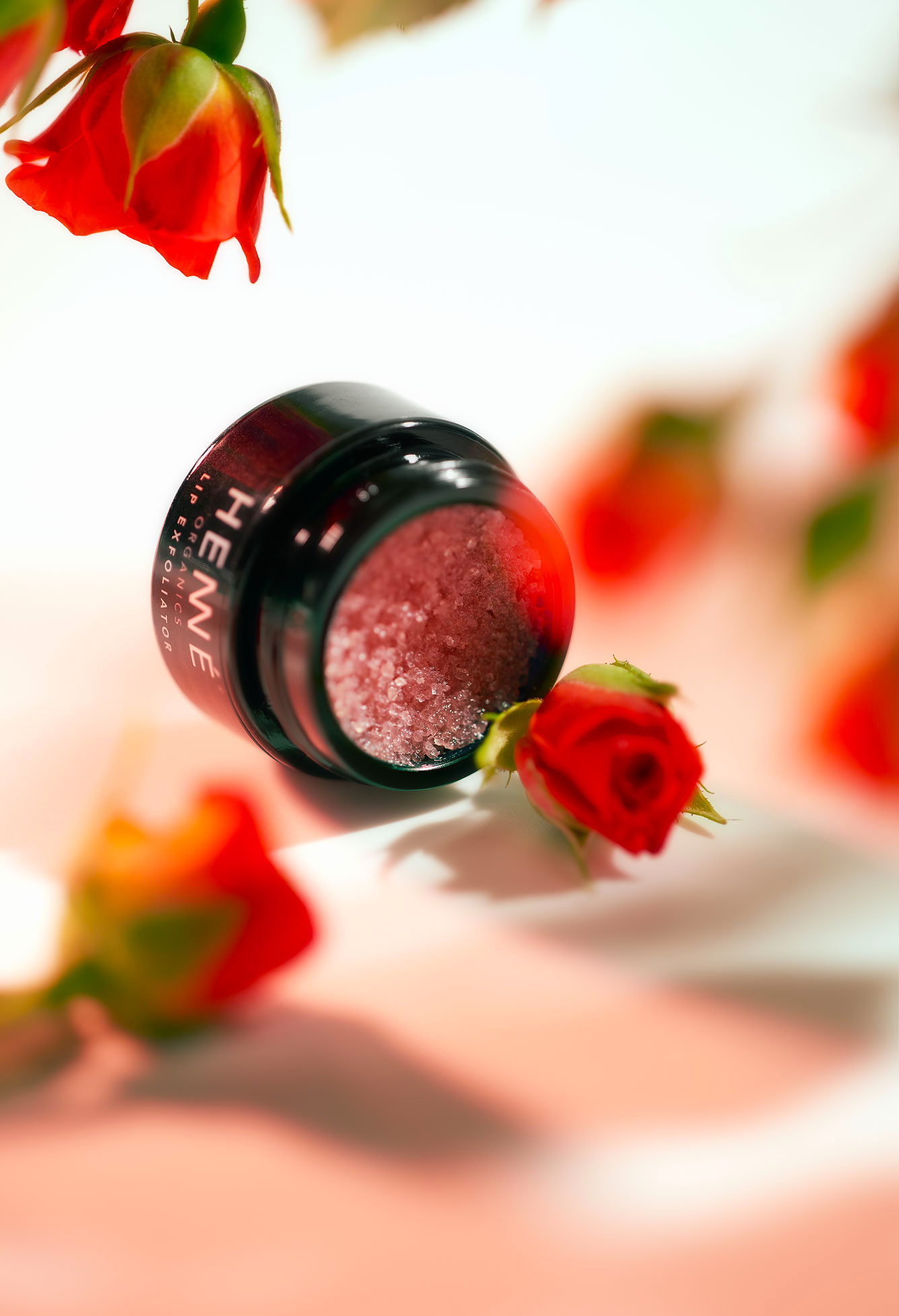 Lip scrub with roses surrounding it