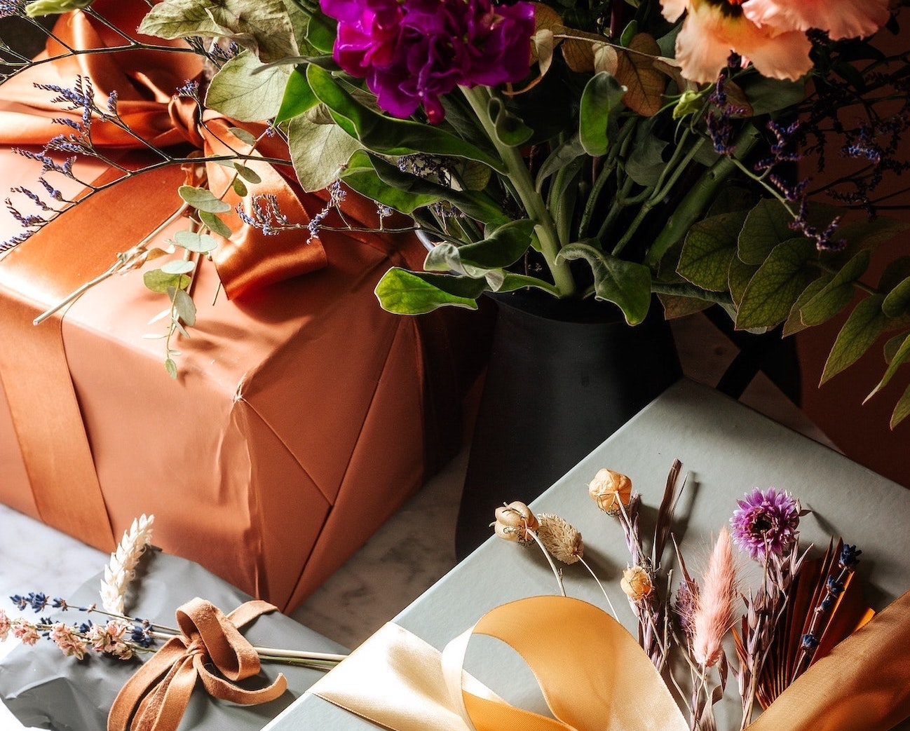 Wrapped gift next to flowers