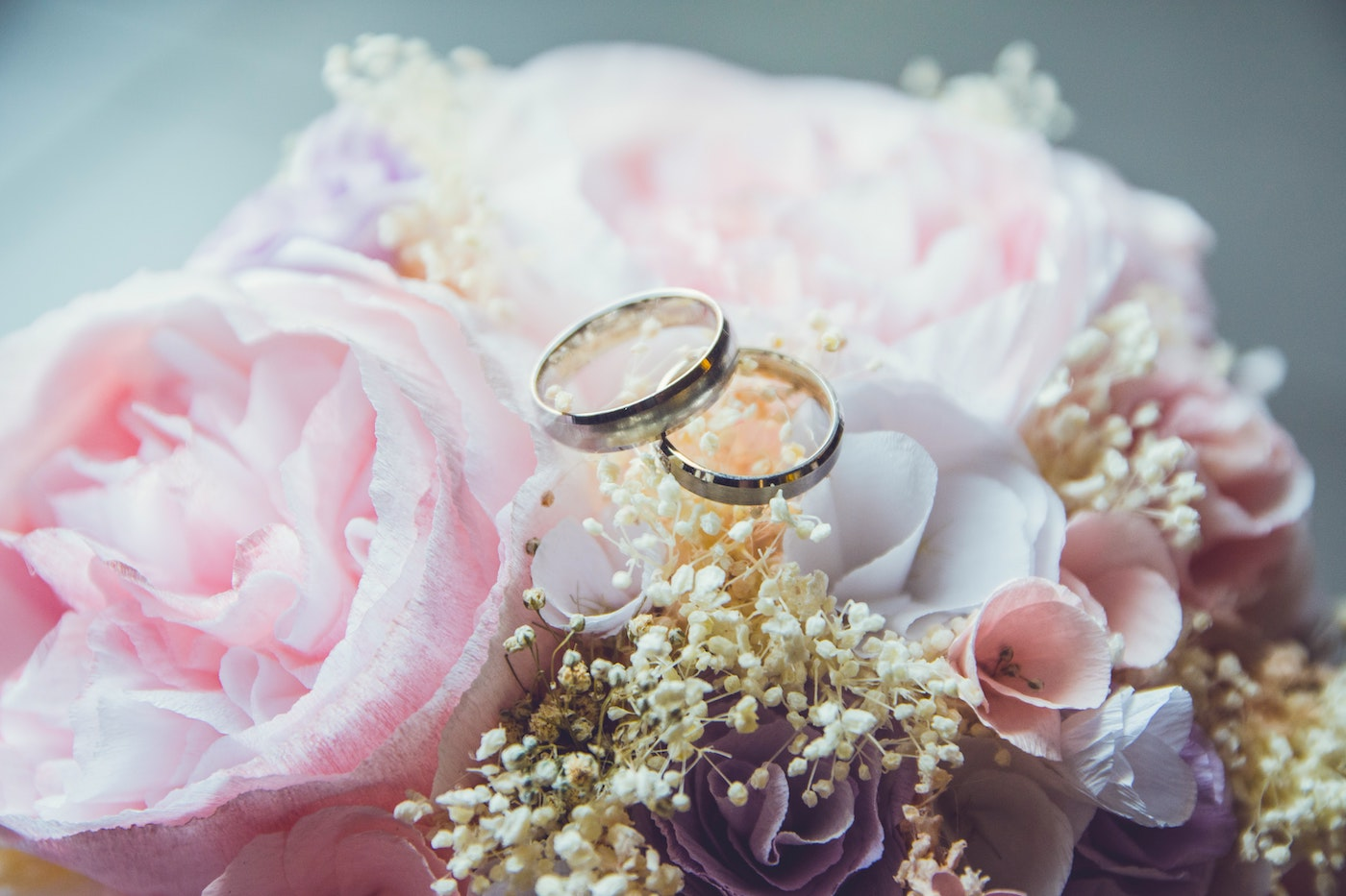 Two wedding rings on top of flowers