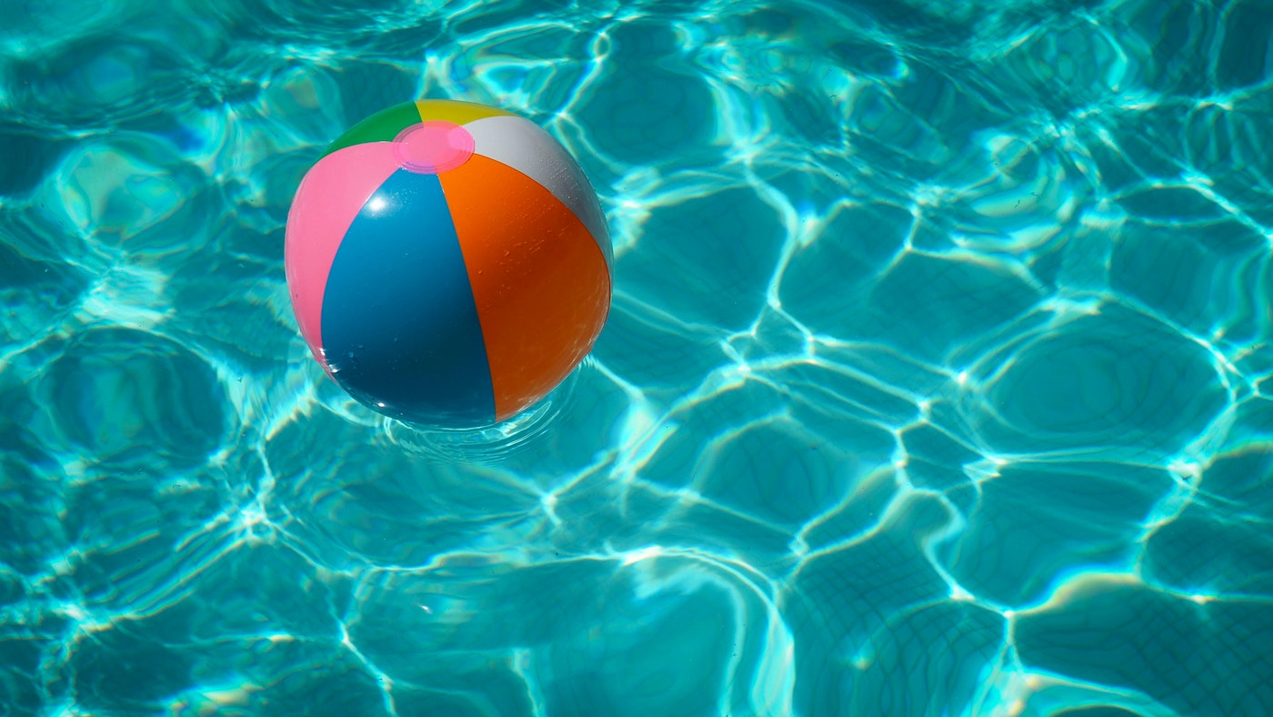 Colorful beach ball in pool