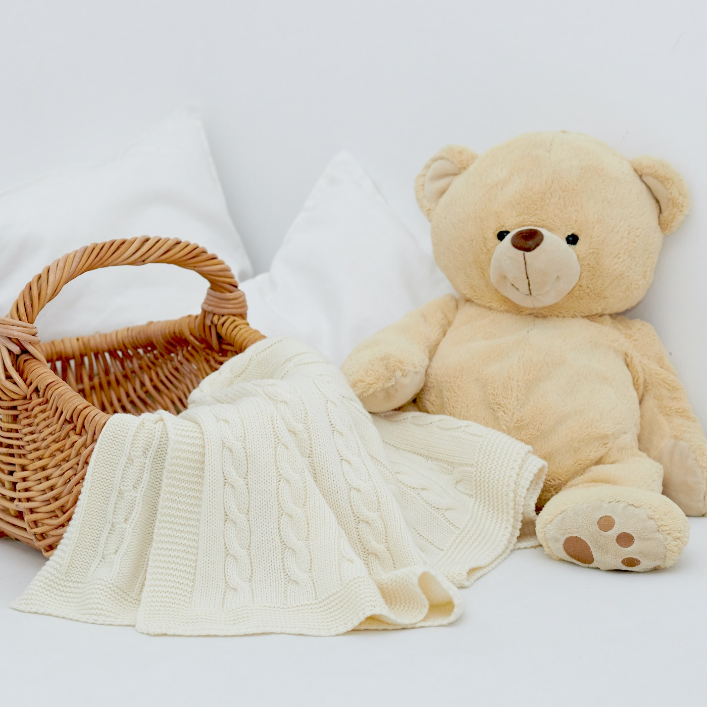 Baby room with basket, blanket, and teddy